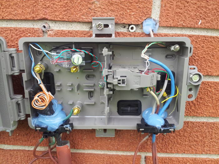 how to install a dsl line network interface box on rear of house