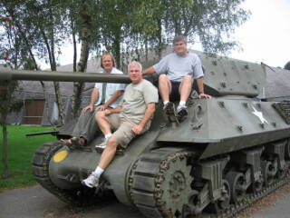 Three guys on a tank.