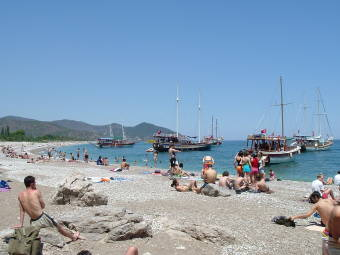 Beach at Olimpos, Turkish sailboats and swimmers.