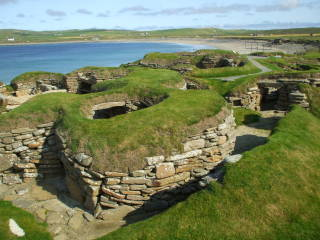 Neolithic dwellings exposed on the beach at Skara Brae in Orkney.