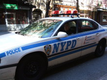 Two NYPD officers took me across town in a patrol car in a counterfeit currency investigation.