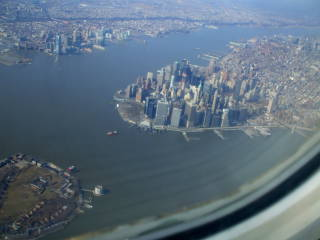Arrive in New York by air and have an aerial view of Manhattan, Governor's Island, and Newark.